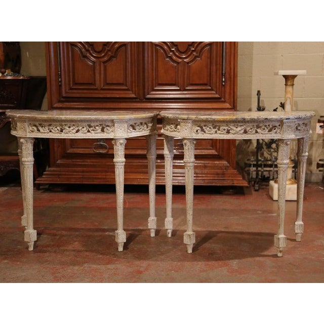 Decorate an entryway with this sophisticated pair of antique consoles tables. Crafted in Southern France circa 1880 and...