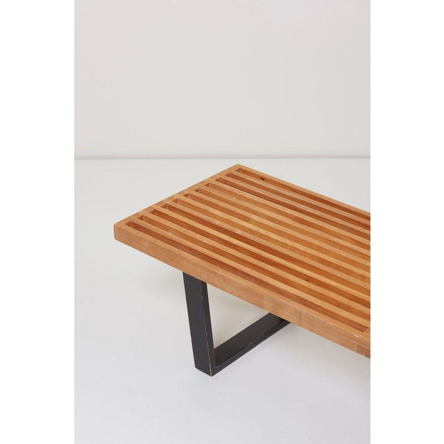 Clean lined modern bench, designed by George Nelson for Herman Miller. This slat bench is constructed from natural solid...