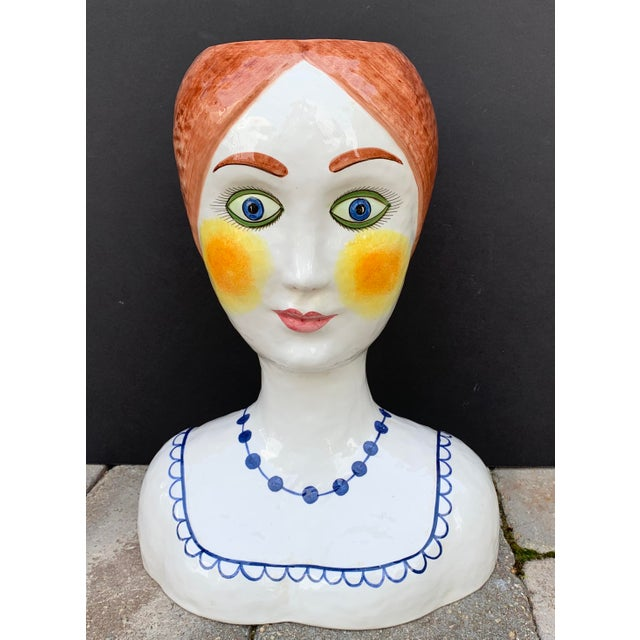 Fabulous piece from the 1960s. Made in Italy, this large handcrafted ceramic head planter / vase is colorfully painted and...