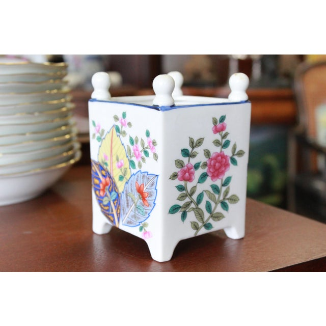 Small reproduction Versailles white porcelain planter in tobacco leaf pattern.