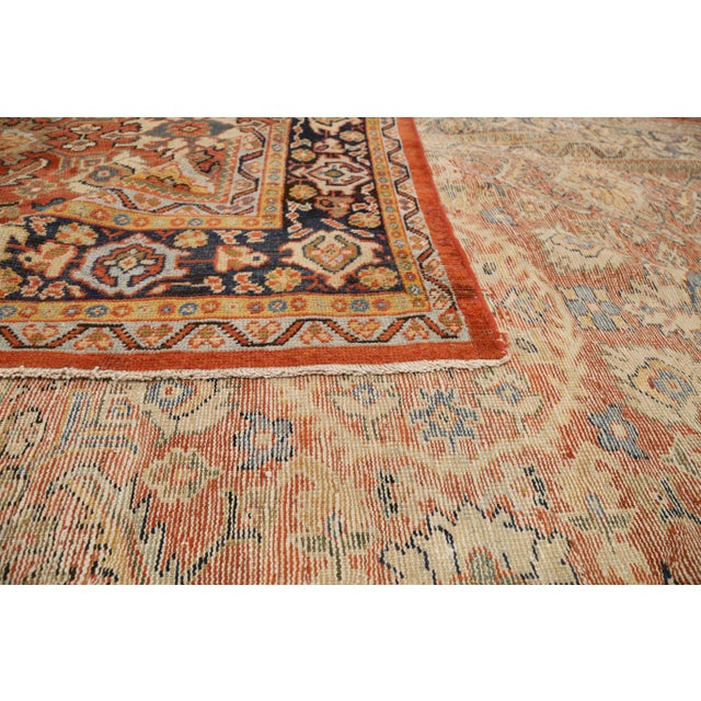 1920s-era antique Persian rug handwoven from exquisite sheep's wool and tinted with all-organic dyes. It was made using a...