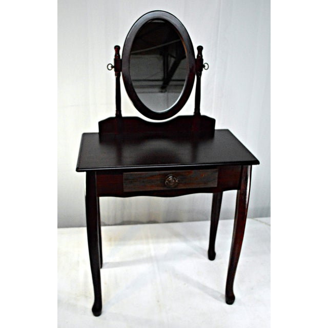 Offered is an adorable Cuban mahogany vanity/dresser with a central drawer. This piece features a framed oval rotating...