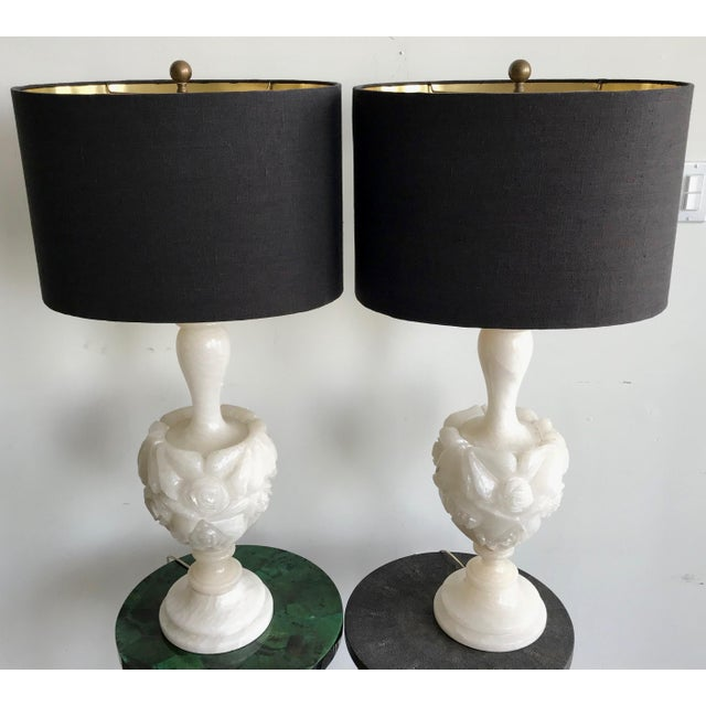 A pair of beautiful floral carved alabaster table lamps from the 1930s, Made from heavy, substantial marble and in great...