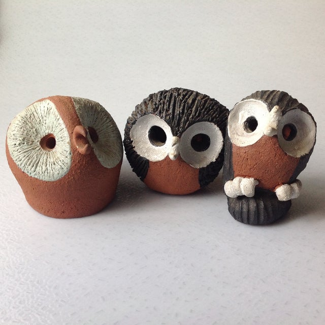 """Hand made red clay studio pottery owls. Large red owl is signed by artist """"b. field"""", larger black and white owl is hand..."""