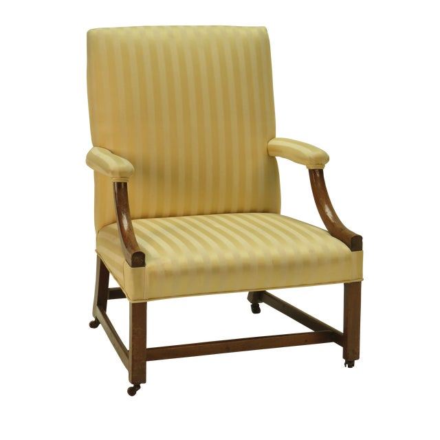 An 18th century English George III period mahogany library chair in a yellow striped silk, circa 1780.
