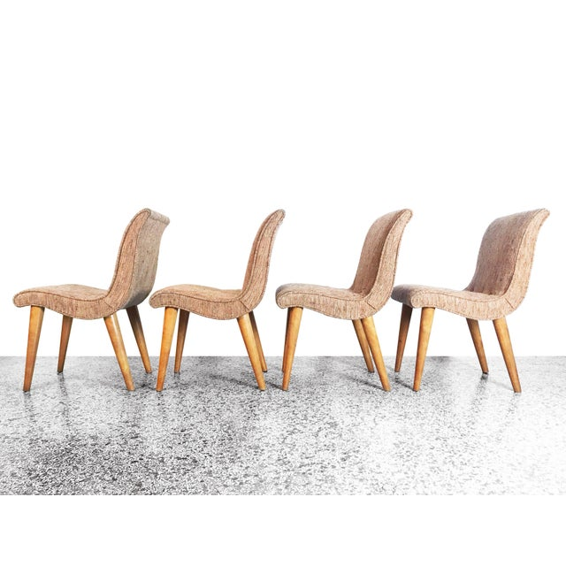 A set of 4 vintage scoop chairs designed by Russel Wright for Conant Ball, 1950s. Solid maple legs with original tweed...