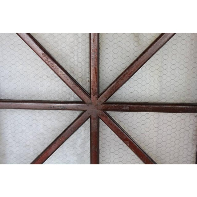 Early 1900s American wood and chicken wire glass window, two available. This listing priced for 1.