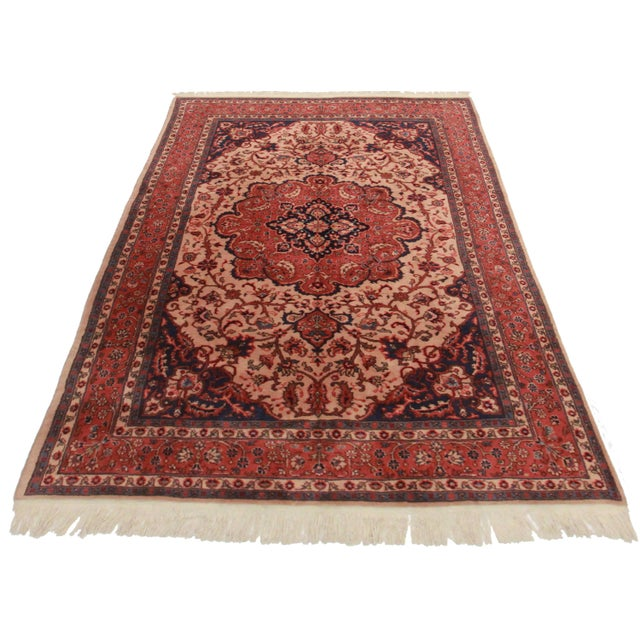 Crafted of hand-knotted wool, this Turkish Sparta rug features an all-over floral design.