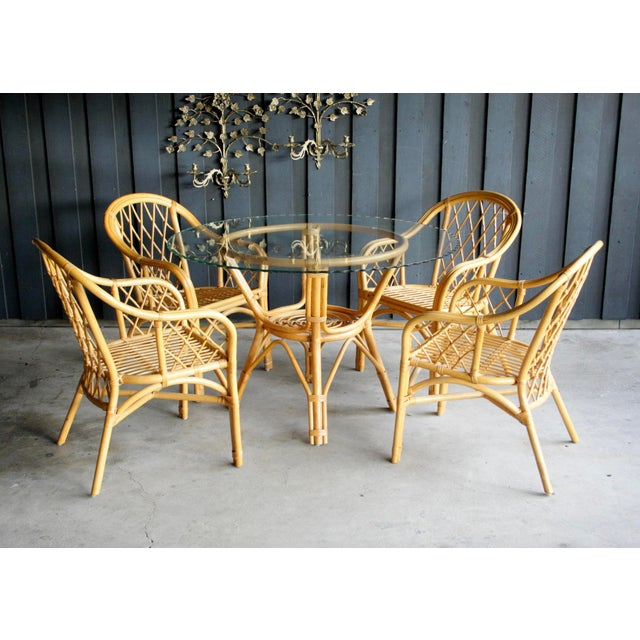 Fantastic set of four diamond patter rattan arm chairs. We love the curves and cross-bracing on these pieces and the fact...