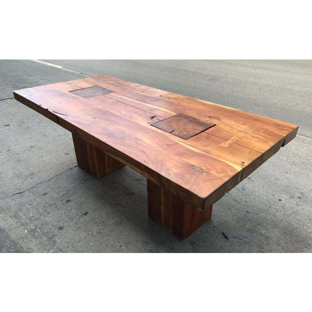 Walnut free edge dining table. Has two columned pedestal inserts. The top is approximately 2 1/2 inches thick. The...