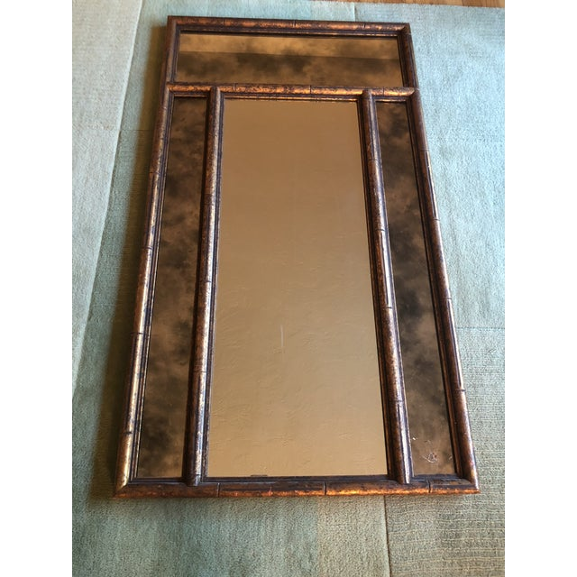 Faux bamboo, surrounding smoked mirrors, this large vintage beauty has it all! Smoked mirrors are surrounding the middle...