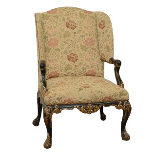 Early 20th Century George II Style Ebonized and Parcel-Gilt Wingback Armchair For Sale
