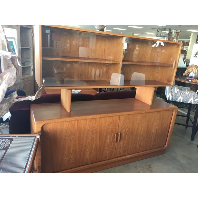 Solid teak mid century modern sideboard with a floating hutch and accordion doors. A true representation of mid century...