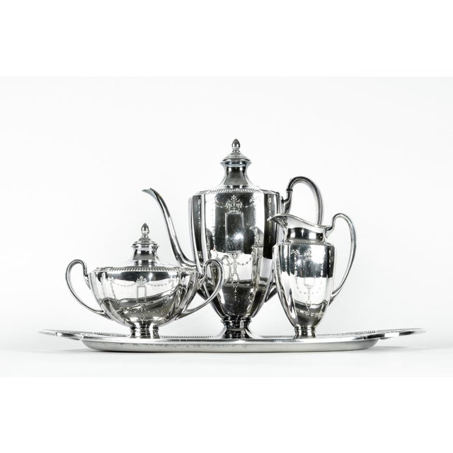 Vintage silver plated tea / coffee service. All together four pieces. Each piece is in excellent condition. The tea /...