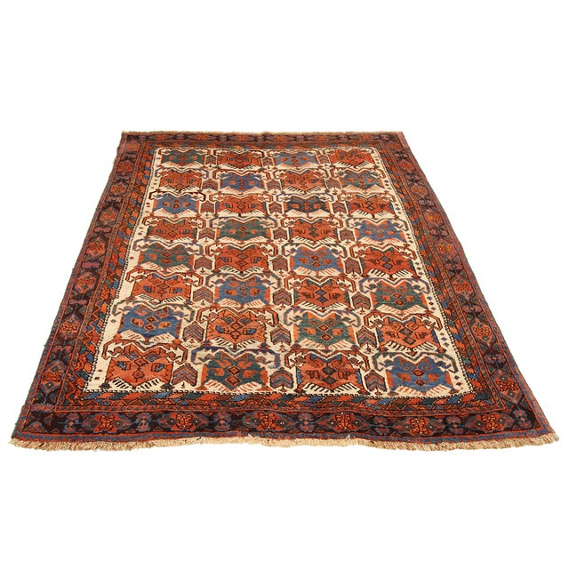 Antique Persian area rug handwoven from the finest sheep's wool. It's colored with all-natural vegetable dyes that are...