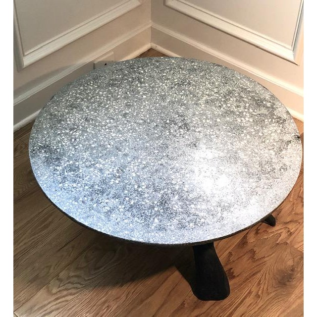 Unique and one of a kind accent table! We paired a round cast stone terrazzo top with a piece of Lake Erie driftwood and a...