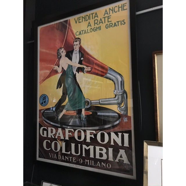 This is an Italian offset lithograph of a vintage 1920's Grafofoni Columbia classic advertising poster, featuring a man...