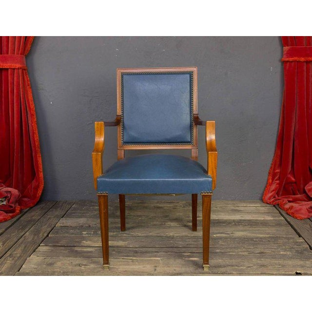 Pair of French, 1940s armchairs in blue leather with mahogany wood frames and brass nailing.