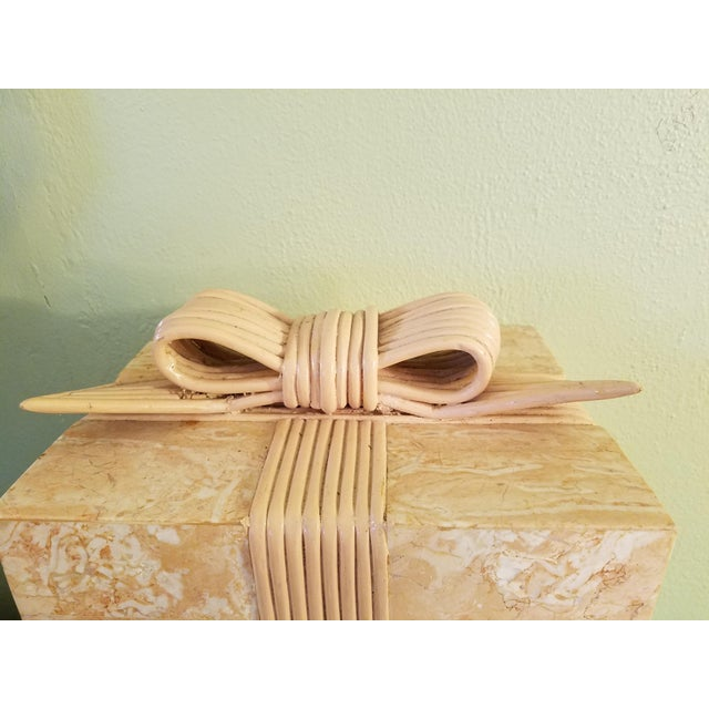 Beautiful Coral Stone veneer box adorned with a bamboo ribbon wrapped around. The interior is a black Velvet look. It is...