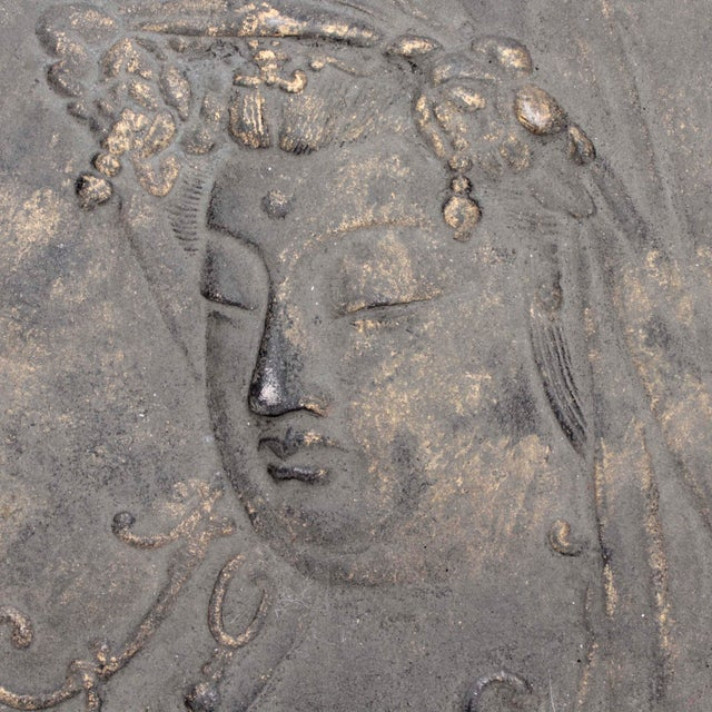 """Antique sand-cast iron 13"""" diameter cameo of a Quan Yin visage hi lighted with metallic gold paint repurposed as wall..."""