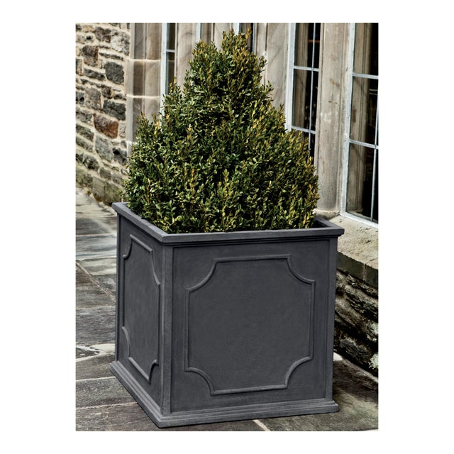 A square planter of Fiber Clay Composite in a lead lite finish. Available in multiple sizes or as a set of four. This...
