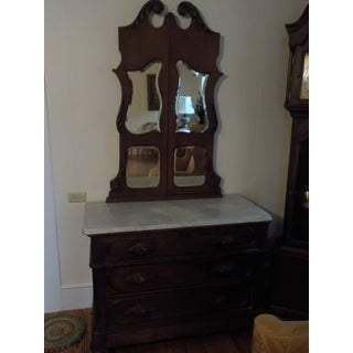 An American Victorian Walnut Marble Top Dresser Together With a Cartouche Shaped Raised Mirror Back in Two Parts. Preview