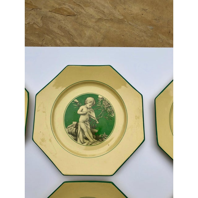 An exquisite set of 8 Sarreguemines Majolica Dessert Plates from France-with cupids decorated in beautiful yellow and...