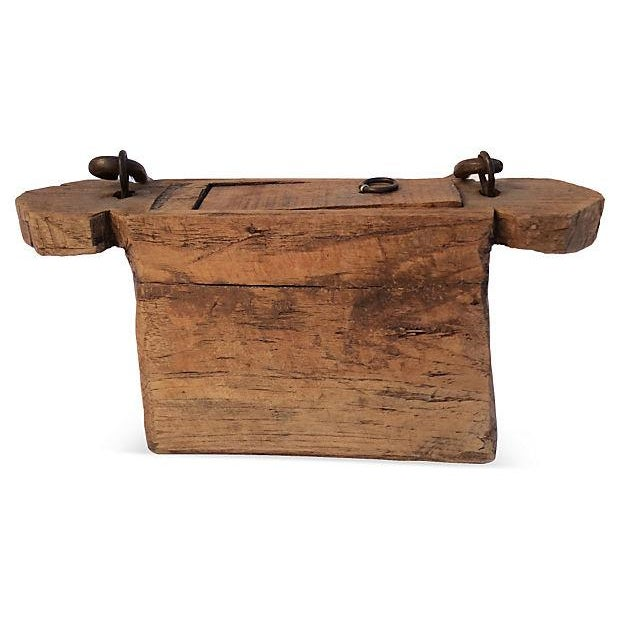 Chinese carved wood box with heavy metal handle. Some wear.