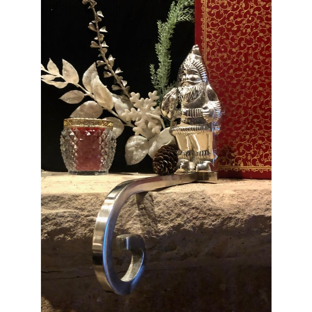 This is for one long handled Christmas stocking hook that is a polished silver plated Santa Claus / St. Nick. He is the...