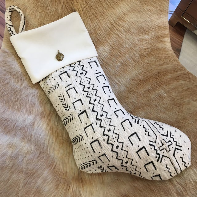 Velvet mixed with mudcloth Christmas stocking. Brass African Face Charm is sewn in as well.