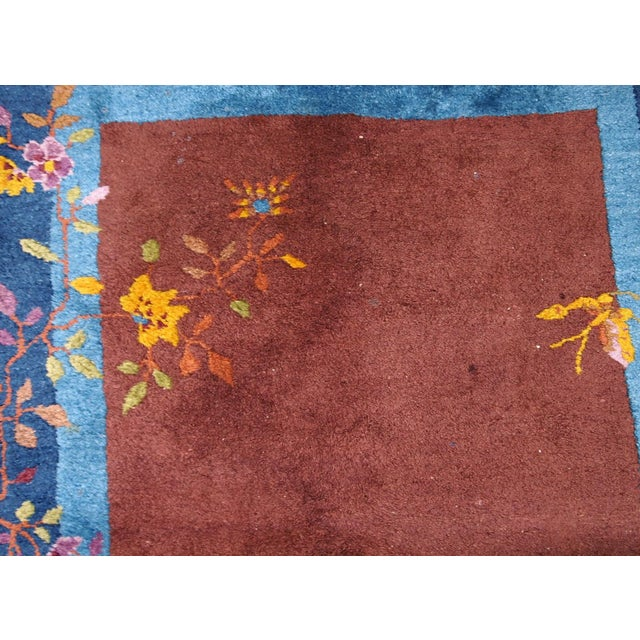 Handmade antique Art Deco Chinese rug in brown and blue shades. The rugs has minimal Art Deco design with vase and...