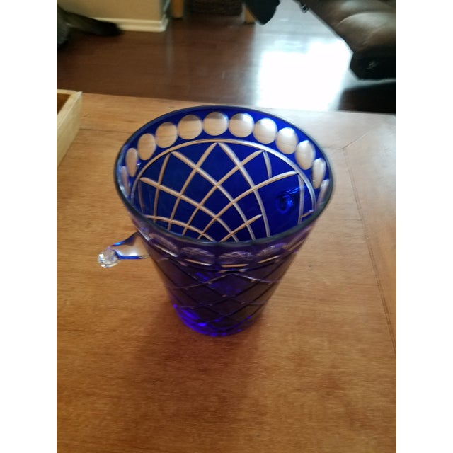 Gorgeous Cobalt Blue Bohemien Cut Crystal Ice Bucket with clear crystal handles. Very unique pattern Perfect Condition.
