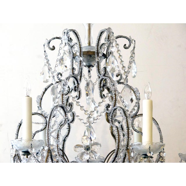 A lustrous and graceful Italian rococo style cage-form beaded 6-light chandelier with crystal pendants, flowers and swags For Sale - Image 4 of 6