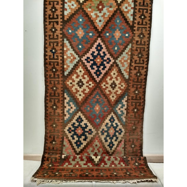 "Beautiful Saveh Kilim runner in characteristic star design and colors. Dimensions: 2'10"" x 12'3"" Date of Manufacture: 2nd..."