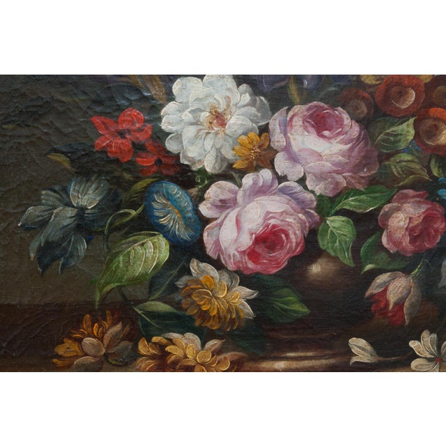 Floral still life oil painting of pink, red, orange, and white flowers. Set in an ornate gold frame. Artist Unknown....