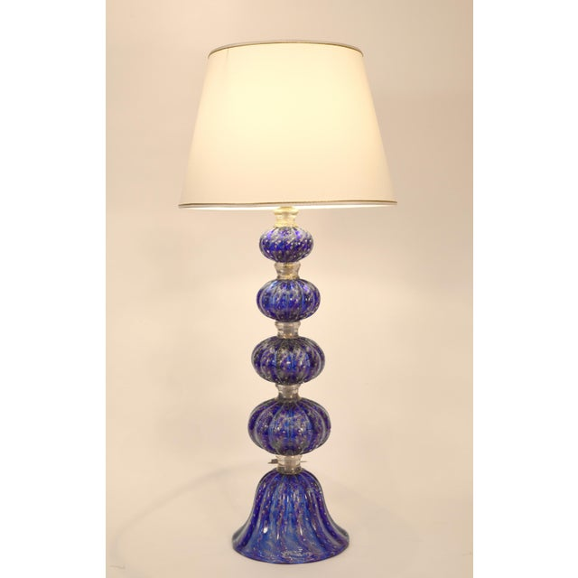 Exquisite cobalt blue with gold flecks Murano glass table / task lamps. Each lamp is in excellent working condition....