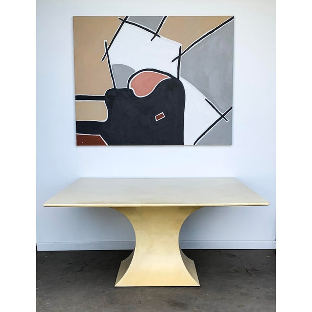 This authenticated Karl Springer dining table is simply spectacular. This Karl Springer goatskin dining table is...