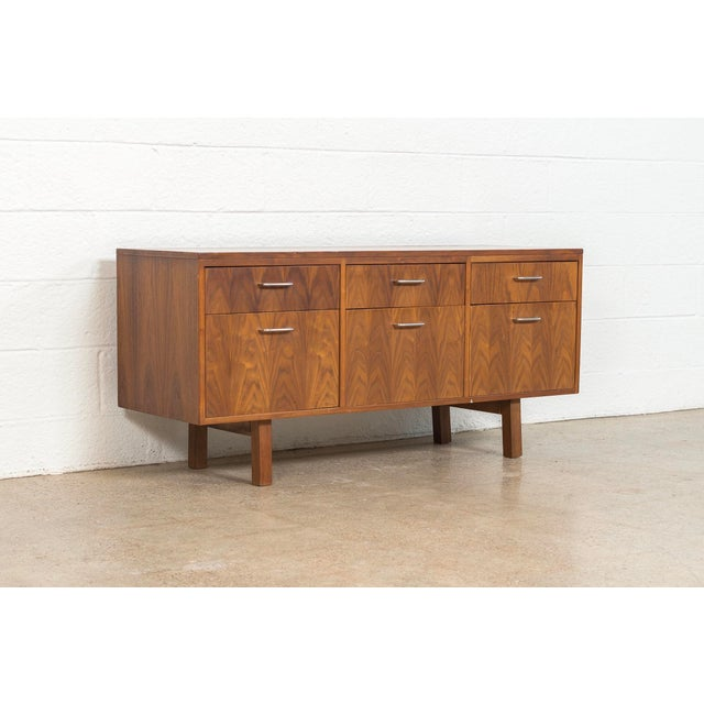 This vintage mid century modern Jens Risom filing cabinet or credenza circa 1960 has classic Danish modern styling with...