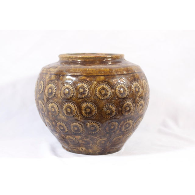 This is a beautiful, simple piece of early 19th century Thai pottery, with a gorgeous floral repeating pattern in a...
