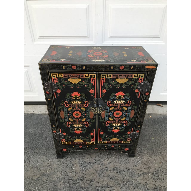 Stunning hand painted chinoiserie cabinet. Double doors with hardware. Vibrant colors. Would make a great piece for your...