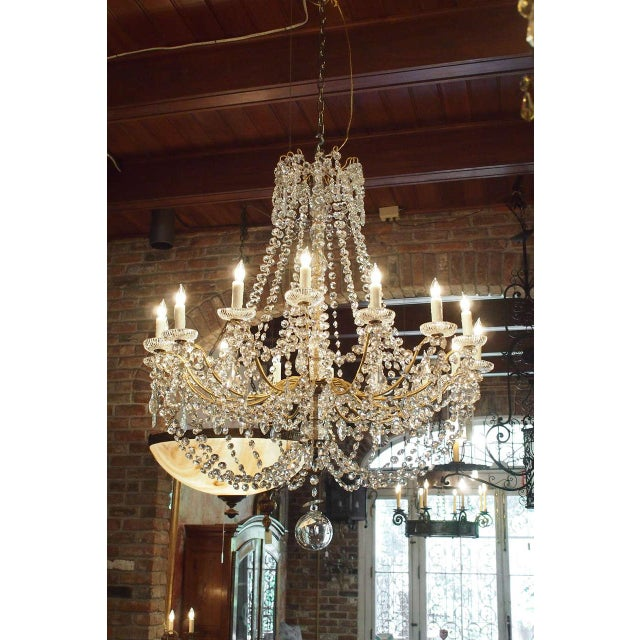 Antique French crystal and bronze 16-light chandelier. Circa 1870.