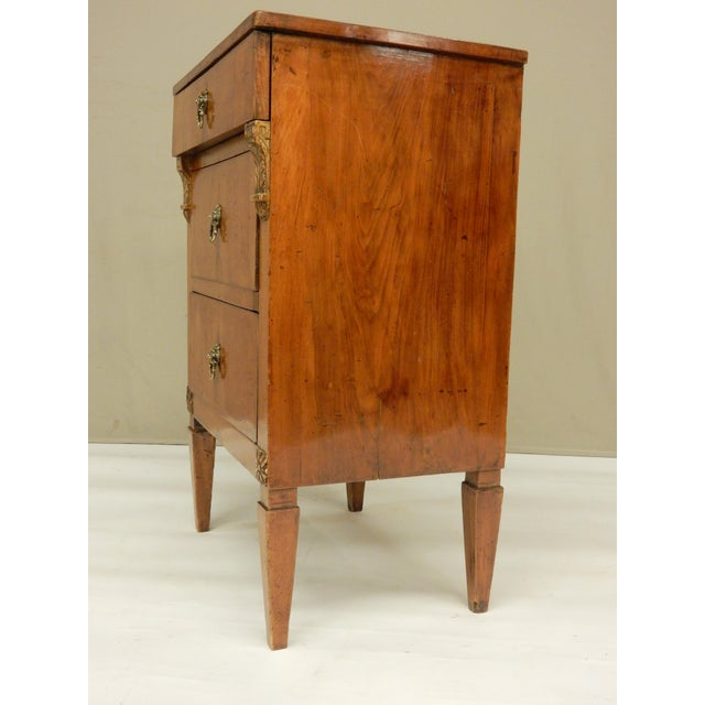 Beautiful small Italian walnut 3 drawer commode. Very elegant design in the neo-classical style.