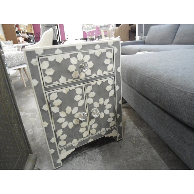 HD Buttercup bone inlay nightstand radial patterns with 1 drawer and 2 doors.