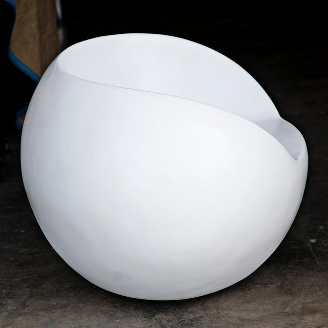 An retro egg shaped lounge chair made of fiberglass which has been newly restored.