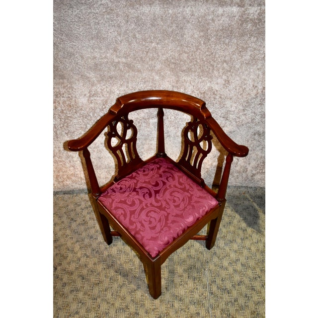 Corner chair has a chippendale style. Made by Hickory Chair Co. The wood is mahogany. Carved back and stretcher base. New...