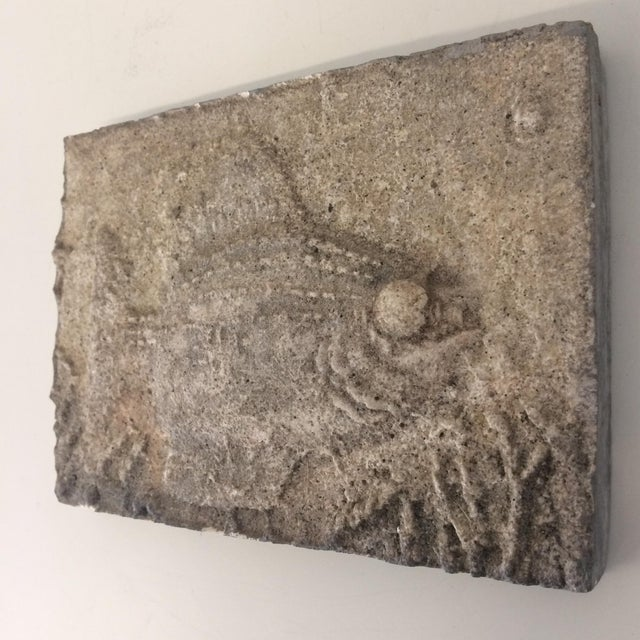 Interesting art tile by artist Jerry Pearson. Tile is made of plaster, stone , concrete and natural elements and depicts a...