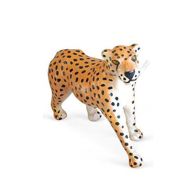 Vintage leather cheetah figurine from the 1970s. Spots are hand painted and eyes are inflated yellow stones. Minor wear...