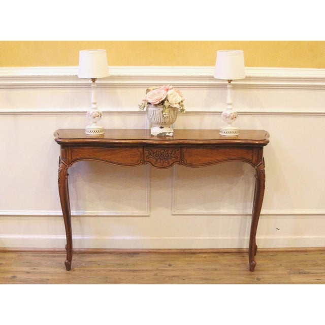 Vintage french country style narrow console table perfect for a hallway, entryway or the back of a sofa. Made by...