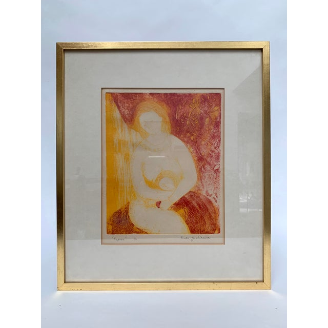 """Framed limited edition print of a mother and child signed Hiroko Yoshikawa, and titled """"Repose."""" Frame measures about..."""