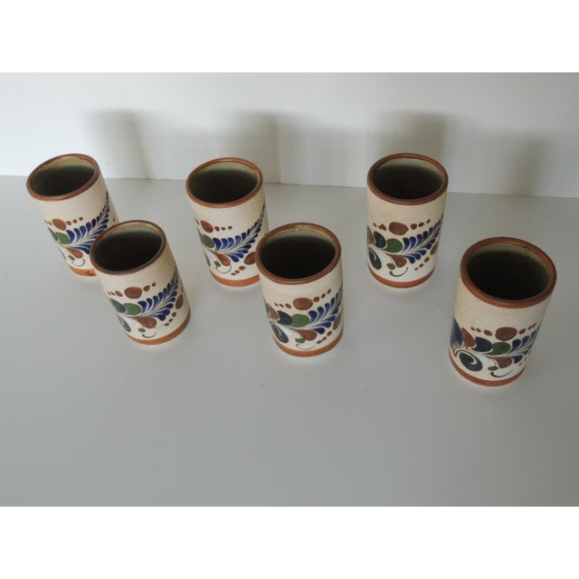 Set of six Mexican Tonala drinking glasses. Depicting colorful feathers. In shades of blue, green, brown and white. Fully...